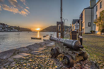 Dartmouth canon on the waterfront at sunset